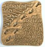 Bronzerelief Spuren im Sand